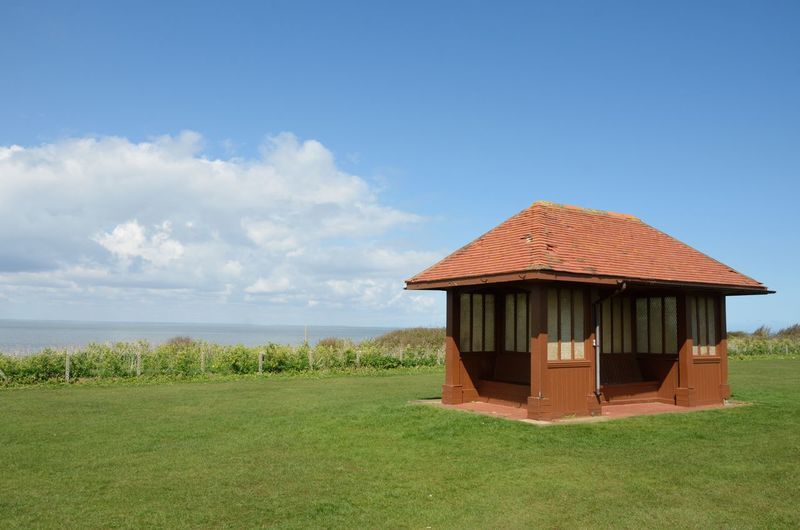 Seaside Shelter by sea in Norfolk UK Architecture Built Structure Building Exterior Building Vintage Shelter Sea Side Hunstanton Norfolk Norfolk Uk No People Cloud - Sky Outdoors