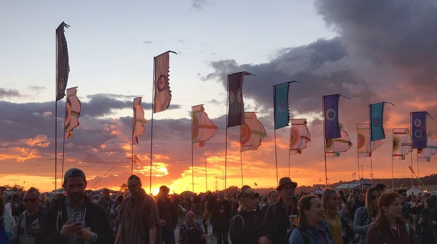 Festival flags at sunset, Glastonbury Glastonbury Festival Glastonbury Sunset Evening Evening Sky Outdoors Festival England United Kingdom