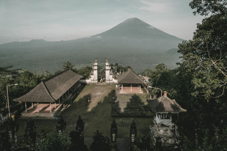 INDONESIA Mount Agung Pura Lempuyang Travel Vulcan Architecture Astronomy Beauty In Nature Building Exterior Built Structure Day Gunung Agung House Mountain Mountain Range Nature No People Outdoors Pura Lempuyang Luhur Scenics Sky Tranquility Tree Volcano Water