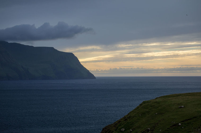 Coastline EyeEm Nature Lover Tadaa Community Beach Beauty In Nature Cloud - Sky Faroe Islands Horizon Horizon Over Water Idyllic Land Mountain Mykines Nature No People Non-urban Scene Outdoors Scenics - Nature Sea Sky Sunset Tranquil Scene Tranquility Water
