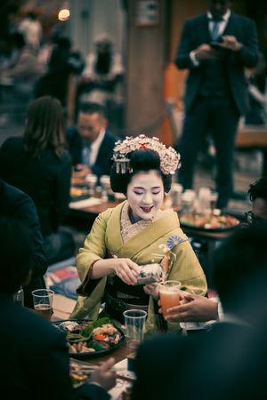 Adult Asahi Beer Celebration Dinner Focus On Foreground Food Food And Drink Geisha Hanami Incidental People Japan Kimono Kyoto Maiko Men People Portrait Real People Sakura Sitting Smiling Traditional Clothing