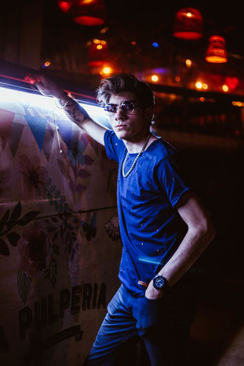Illuminated Night Standing Young Adult Casual Clothing Front View Lifestyles Blue Looking Glasses Fashion One Person Headshot Rock Earings Swagger  Backlight Cool Attitude Neon Lights Future Vans Party Boogie Taxi
