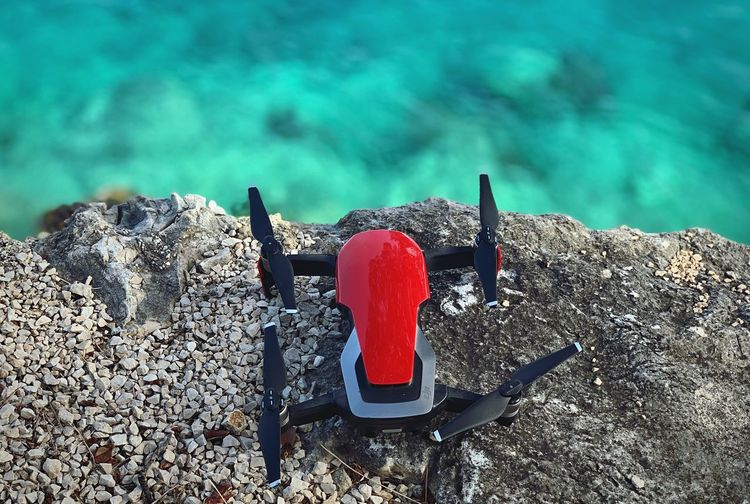 A drone Red Water No People Nature Day Sea Outdoors High Angle View Sunlight Close-up Land Beach Transportation Pier Solid