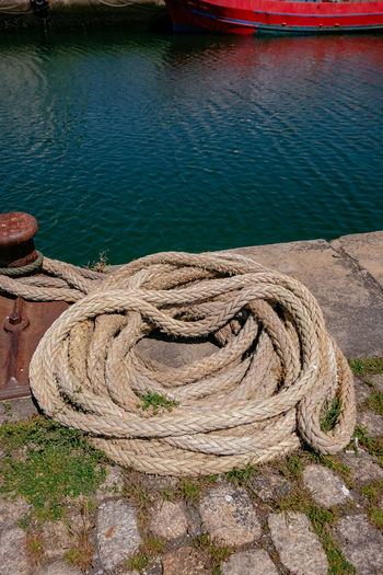 High angle view of rope tied to fishing at harbor