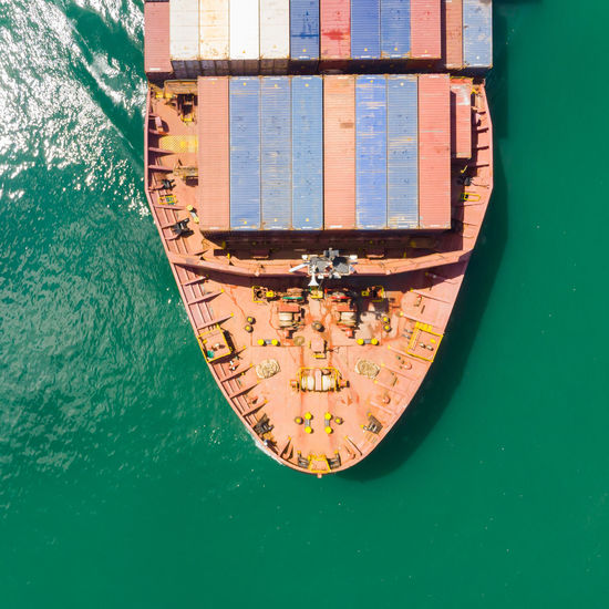 High angle view of boat moored in sea against building