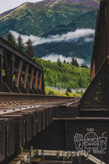 Low angle view of train on mountain against sky