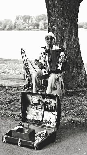 Street Musician Streetphotography Street Musicians Oldman Oldmanportrait Men Sitting Musical Instrument Music