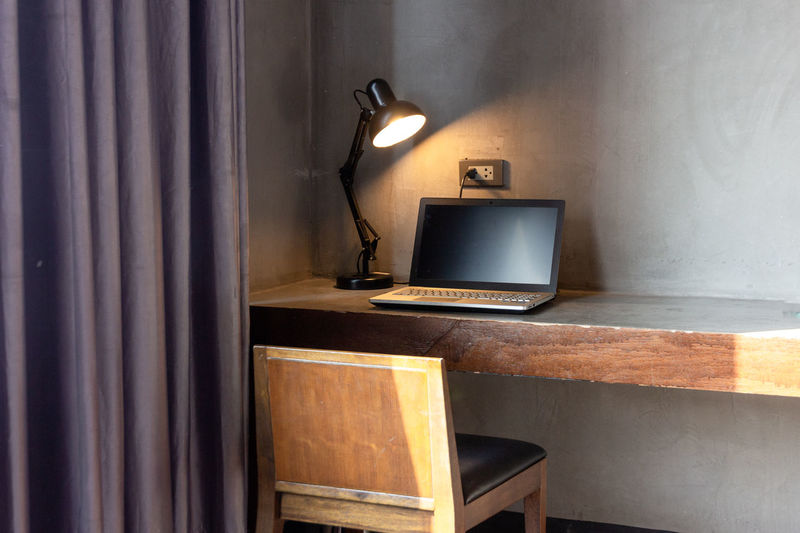 laptop with lamp on table in the room Technology Indoors  Wall - Building Feature No People Retro Styled Table Connection Communication Lighting Equipment Electric Lamp Domestic Room Home Interior Music Furniture Illuminated Old Absence Still Life Day