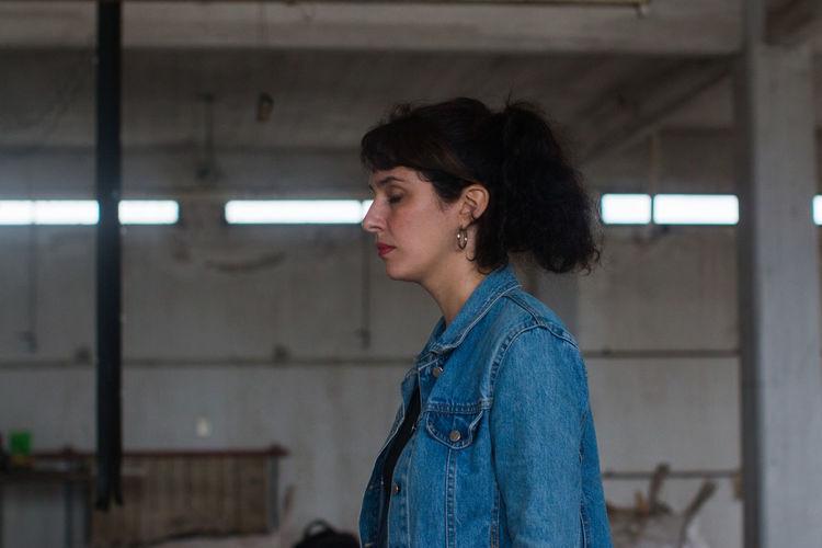 Side portrait of beautiful woman wearing jean jacket