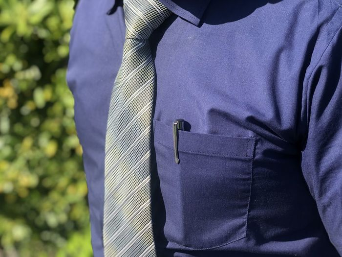 Close view of tie knot with shirt