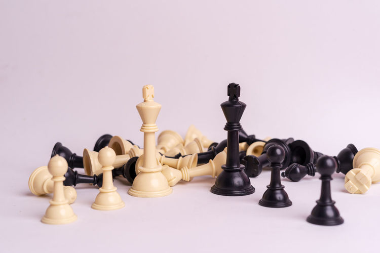 Chess set on white background. Indoors  Chess Game Competition Queen King - Royal Person King Army Strategy Leader Leadership Decisions Leisure Games Board Game Studio Shot Chess Piece King - Chess Piece Black Color Relaxation Copy Space No People Leisure Activity Pawn - Chess Piece White Background Large Group Of Objects Arts Culture And Entertainment Chess Board Queen - Chess Piece Knight - Chess Piece