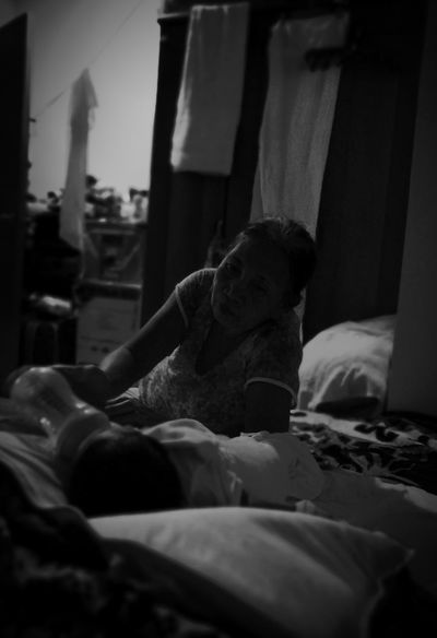 Love and Care Indoors  Adult People Only Women One Woman Only Real People DayWomen Around The World Phone Phoneography Phone Photography Huaweiphotography Huaweigr52017 Philippines Womenoftheday Mother Motherslove Grandmother And Grandchild Dramatic Black And White Candid Portraits The Portraitist - 2017 EyeEm Awards