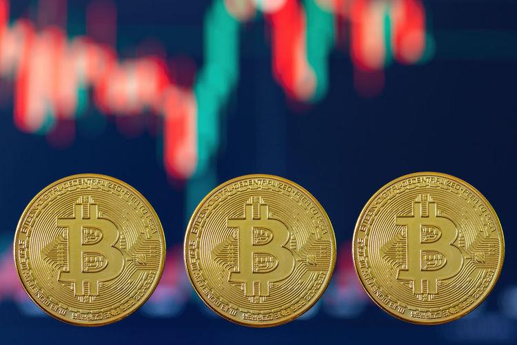 Close-up of illuminated coins