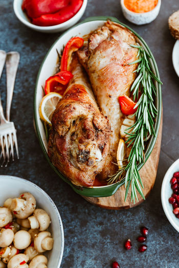 Turkey Christmas Roasted Thanksgiving Dinner Roast Chicken Food Table Rustic Meat Meal Holiday View Top Background Celebration Rosemary Cooked Baked Poultry Gourmet Traditional Red Delicious Legs Flat Lay Creative Vibrant Snack Pomegranate Grilled Vegetables Lunch Diet Festive Above Served Dish Season  Whole Leftover Decoration Setting Decorative Winter Autumn