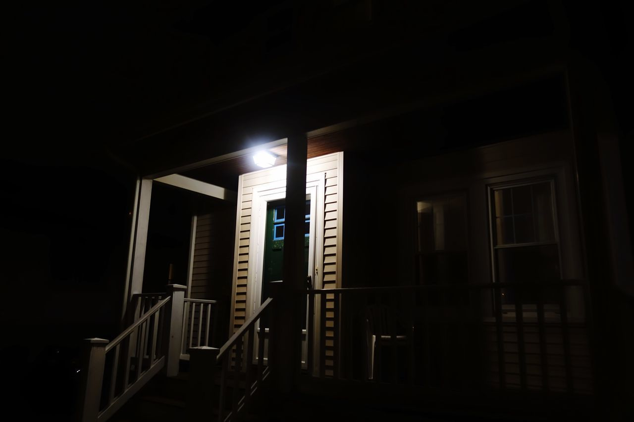 illuminated, architecture, railing, built structure, night, dark, no people, steps and staircases, indoors, building exterior, open door