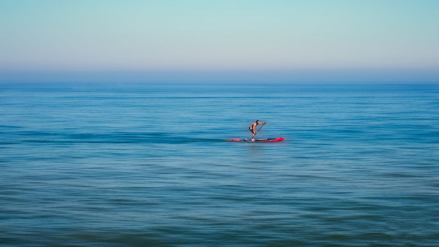 Stand up paddle board man paddleboarding standing on paddleboard on blue water Malaga Mediterranean Sea Stand Up Paddle Stand Up Paddling Adult Blue BOARD MAN Day Floating On Water Horizon Horizon Over Water Leisure Activity Men Mid Adult Nature Nautical Vessel Oar Outdoors Paddle Board Paddle Boarding People Roberto Sorin Sea Sky Tranquil Scene Transportation Two People Water The Street Photographer - 2018 EyeEm Awards Summer Sports
