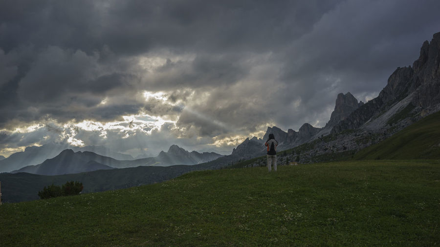 Adventure Day Full Length Grass Hiking Landscape Lifestyles Men Mountain Mountain Range Nature One Person Outdoors People Real People Scenics Sky Standing Tranquility Passo Giau Colle Santa Lucia San Vito Di Cadore Dolomites Italy Alps Lost In The Landscape