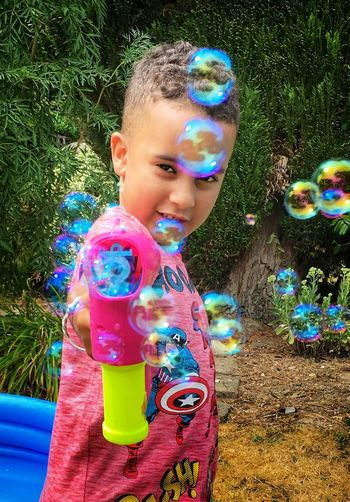 Bubble Gun Fun Bubble Gun Childhood Child One Person Bubble Leisure Activity Innocence Real People Bubble Wand Cute Lifestyles Outdoors