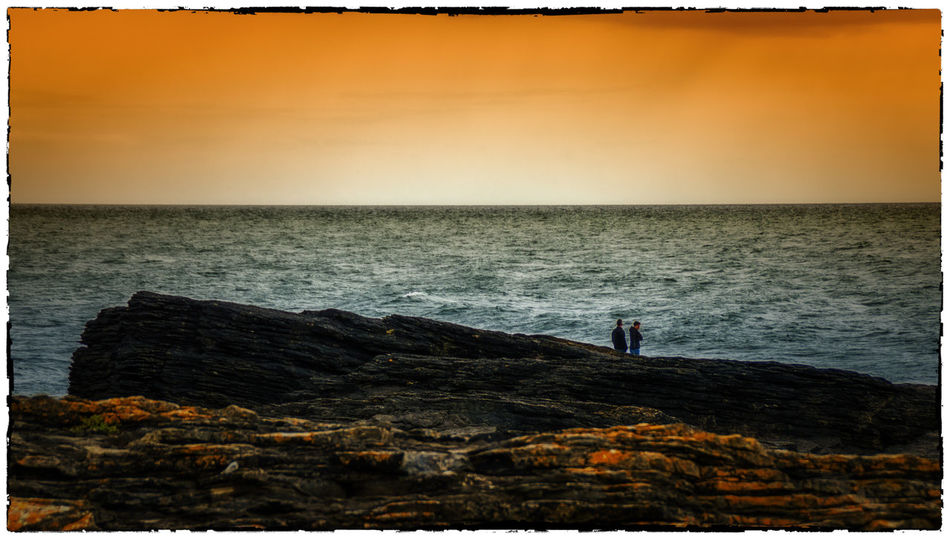 Beauty In Nature Hook Head, Ireland Horizon Over Water Ireland Irelandinspires Ireland🍀 Leisure Activity Lifestyles Orange Color Outdoors Remote Rippled Rock - Object Rock Formation Scenics Sea Seascape Sky Standing Sunset The KIOMI Collection Tranquil Scene Tranquility Water Wexford