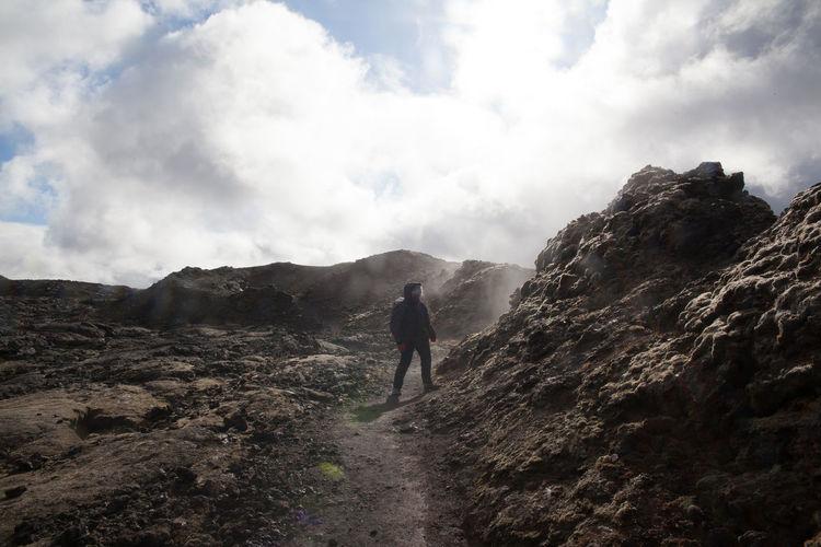 Geologist exploring rocky landscape