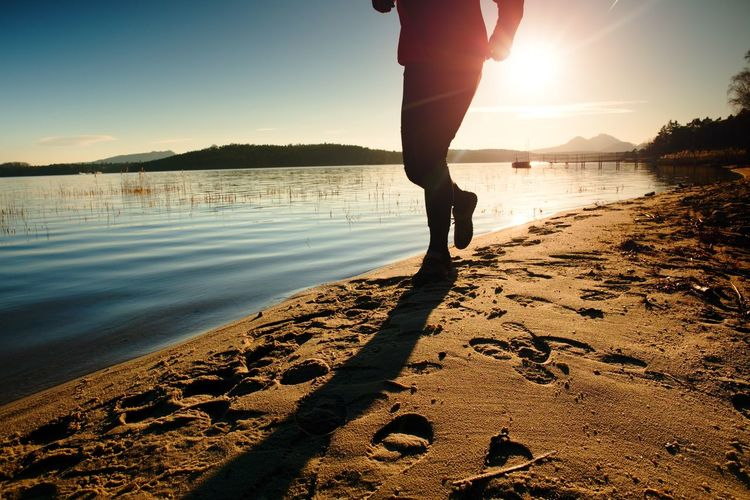 Man in running cloths at amazing sunset in sport and healthy lifestyle concept. training workout