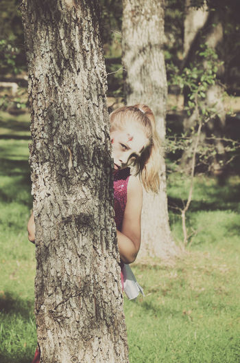 Costume Day Dressing Up Girl Grass Halloween Hiding Kid Outdoors Scary Tree Tree Trunk Zombie