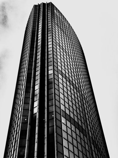Mirrored black Rotterdam Architecture. Architecture Low Angle View Modern Built Structure Skyscraper Building Exterior Tower Corporate Business Sky Outdoors No People Rotterdam Travel Photography Travel Black And White Collection  Black And White Photography Rotterdam Architecture Blackandwhite City IPhoneography