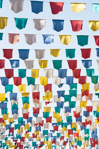 Colorful flags in the sky Colors Low Angle View Nikon Abundance Arrangement Backgrounds Colorful Creativity Design Flag Flags Full Frame Geometric Shape In A Row Italy Large Group Of Objects Multi Colored No People Pattern Photography Repetition Shape Side By Side Sky Variation
