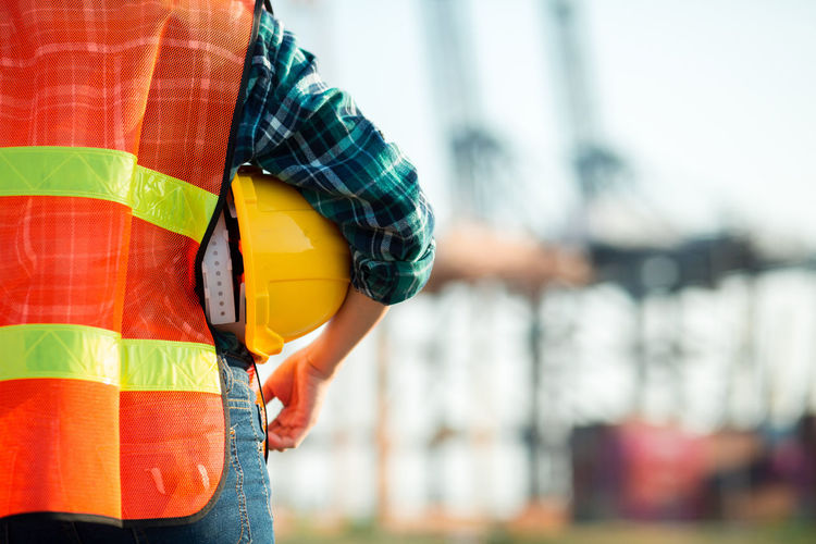 Close-up of people at construction site