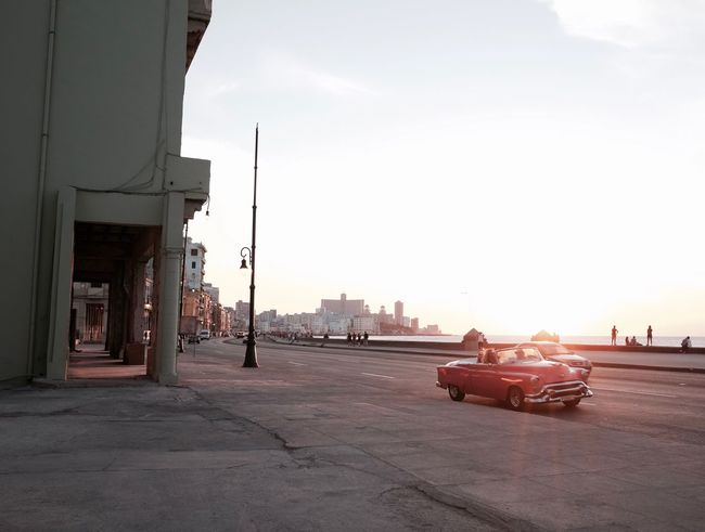 Architecture Sky Built Structure City Outdoors Sunlight Day Adult Men Adults Only One Person Building Exterior One Man Only Cityscape Only Men People Parking Garage Young Adult Havana Malecon Cars Been There. Done That.