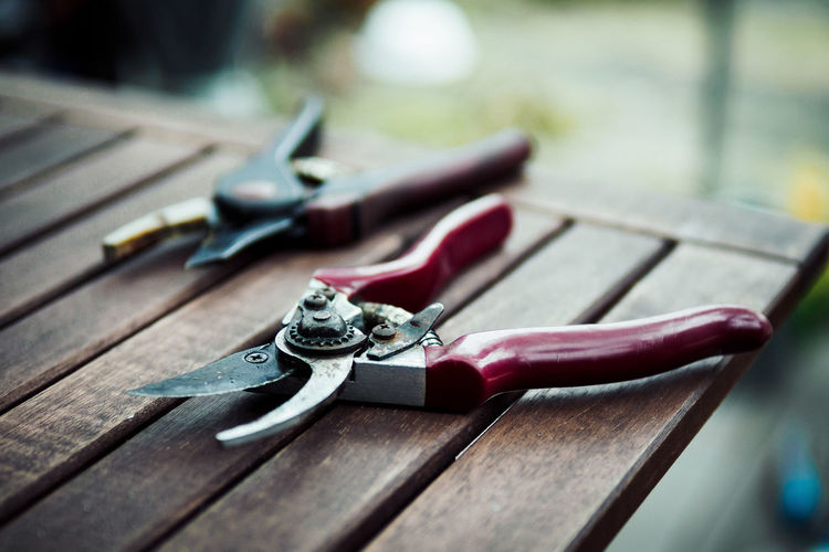 Close-Up Of Pruning Shears On Table