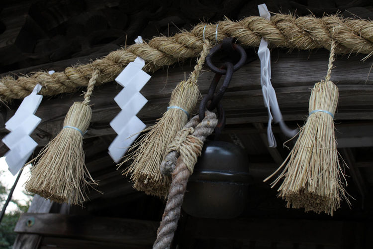 Low angle view of tied hanging on rope