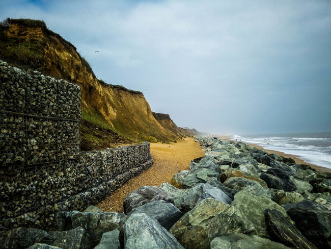 Beach Beauty In Nature Cloud - Sky Coast Coastal Defences Day Gabion Horizon Horizon Over Water Land Landscape Nature No People Non-urban Scene Outdoors Rock Rock - Object Scenics - Nature Sea Sky Solid Stone Wall Tranquil Scene Tranquility Water