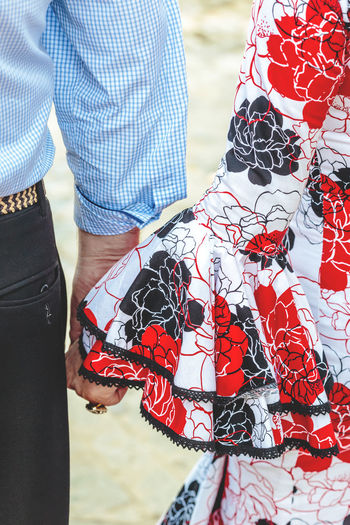 Spanish flamenco dress. Young couple holding hands. Andalusia Andalusian April Beautiful Cultures Dance Dress Fashion Feria De Abril Flamenco Folklore Horse People Sevilla Seville SPAIN Spring Style Sunset Traditional Traditional Clothing Traditional Culture Traditional Festival Woman Day Women