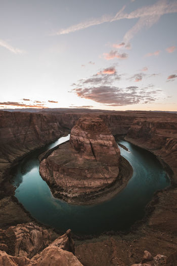 View from above of the majestic Horseshoe Bend during sunset Sky Water Cloud - Sky Rock - Object Sunset No People Travel Destinations Rock Formation Eroded Landscape Nature Still Life Travel Travel Photography Horseshoe Bend Horseshoe View From Above Sky And Clouds Landscape_Collection Outdoors Outdoor Photography Road Trip River View Sunset_collection My Best Photo
