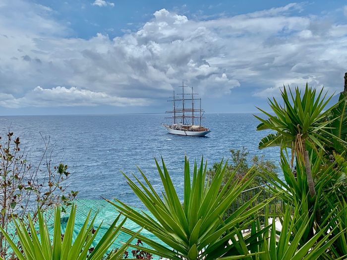 Nautical Vessel Water Sky Transportation Sea Mode Of Transportation Cloud - Sky Tropical Climate Travel Sailboat Day Nature Tree Beauty In Nature Tranquility Scenics - Nature Plant Palm Tree Tranquil Scene Outdoors