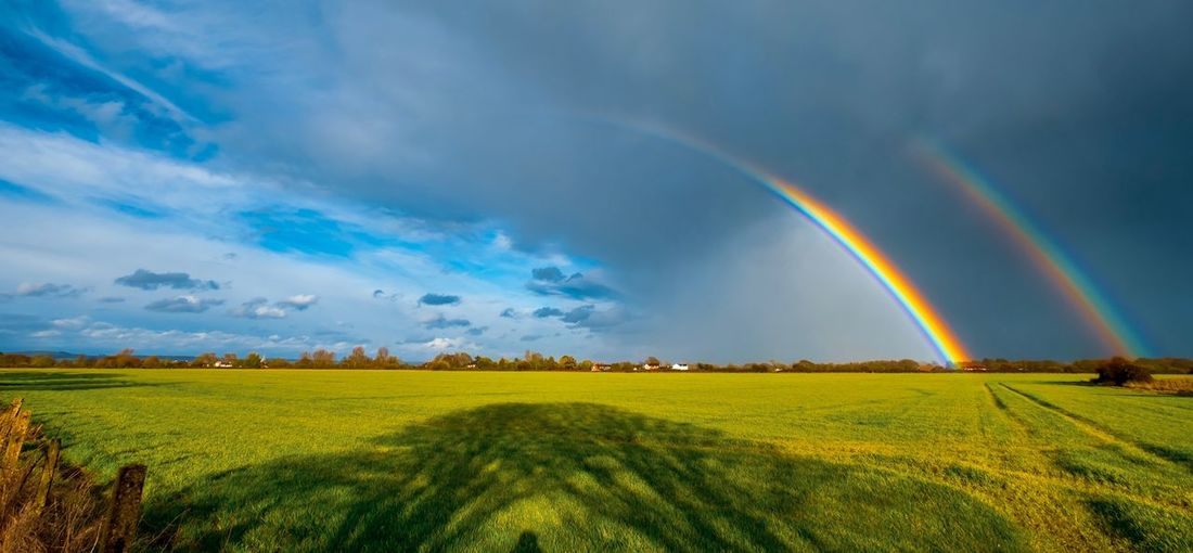Beauty In Nature Landscape Environment Sky Field Scenics - Nature Land Cloud - Sky Tranquil Scene Plant Tranquility Rainbow Rural Scene Nature Idyllic No People Agriculture Grass Double Rainbow