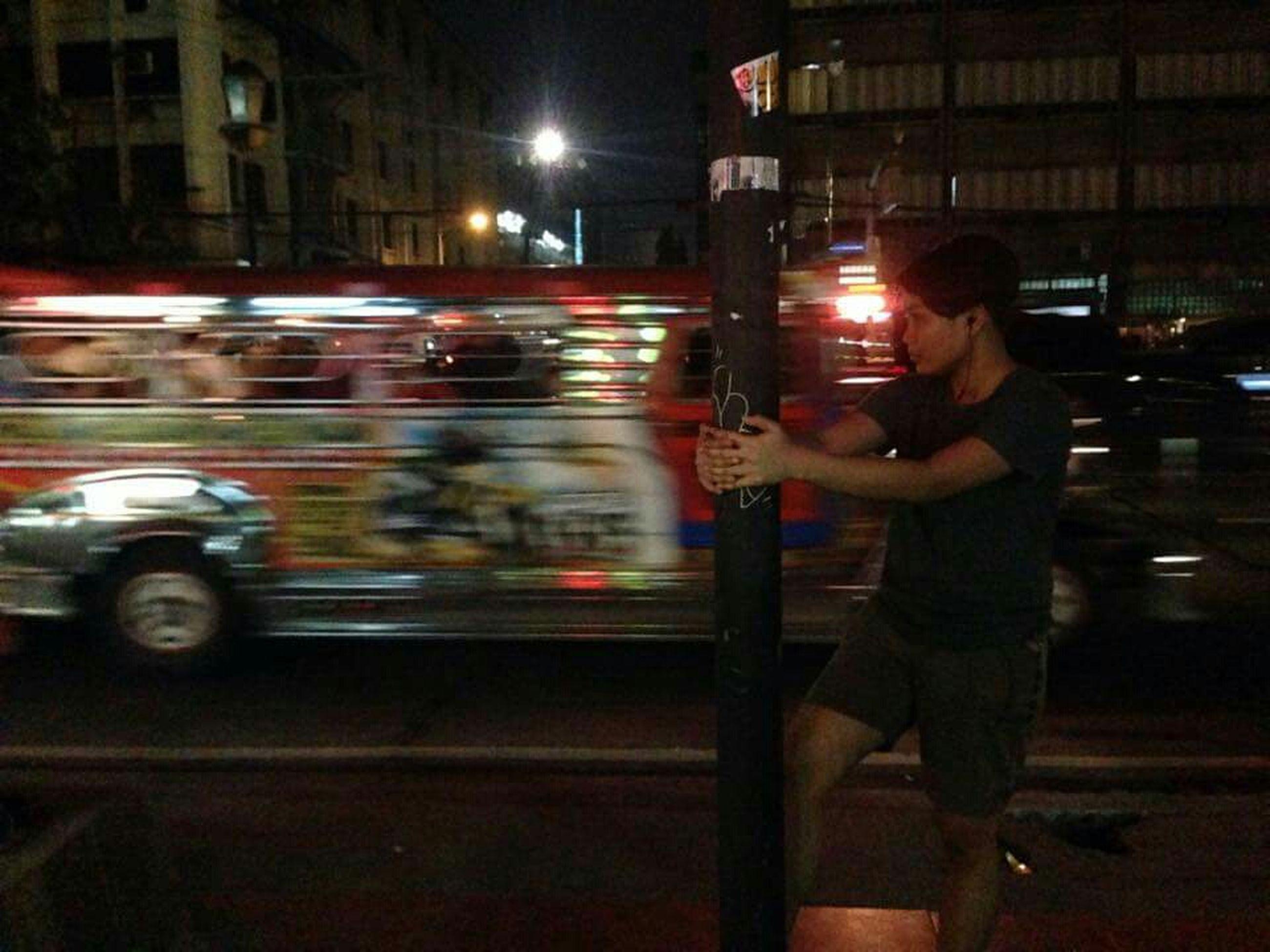 transportation, mode of transport, land vehicle, night, illuminated, street, car, motion, blurred motion, on the move, city, city life, road, speed, travel, city street, men, lifestyles