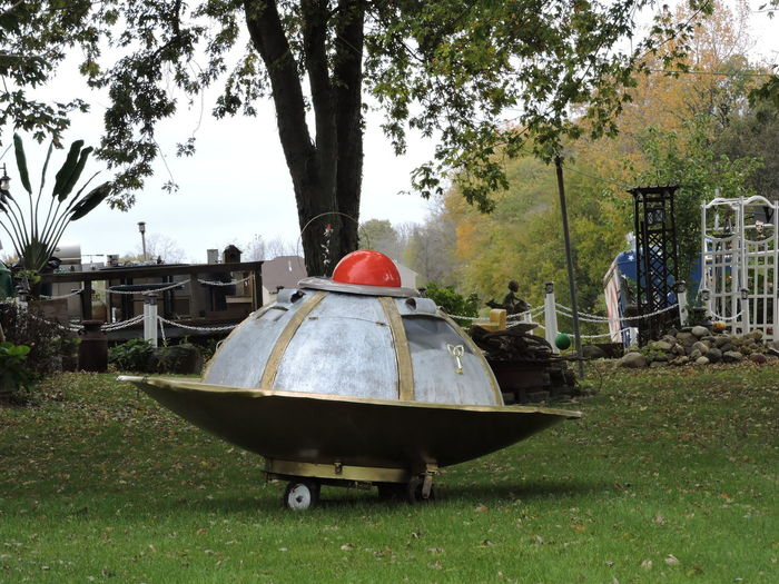 Our neighbors do have a flying saucer. They decorated it and put it in the front yard for Halloween. :D:D Flying Saucer Halloween_Collection Architecture Day Field Front Yard Photography Grass Growth Nature No People Outdoors Sky Tree