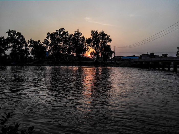 Sunset Reflection Water Outdoors Sky No People Nature Gujranwala HuaweiMate7 Phone Photography Pakistan Mobilephotography Skycolours Huawei CanalSide Canal EyeEm Vision گوجرانوالہ پاکستان آسمان  سورج غروب_الشمس غروب_الشمس غروب_آفتاب نہر