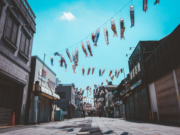 Alley Architecture Building Building Exterior Built Structure Bunting City Cloud - Sky Day Decoration Direction Hanging Low Angle View Nature No People Outdoors Residential District Sky Street Text The Way Forward