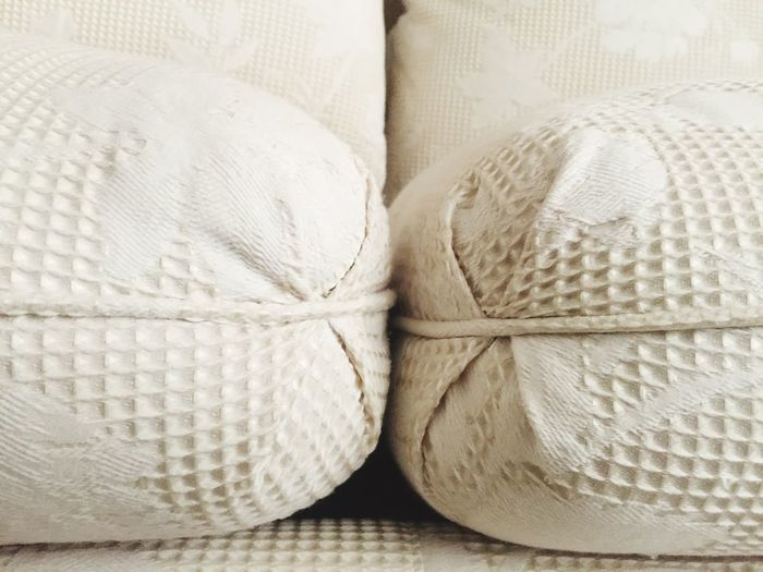 Close-up Extreme Close-up Cushions  Couch Sofa Upholstery Textiles Pattern Texture Piping White White Color Neutral Waffle Print Tucked