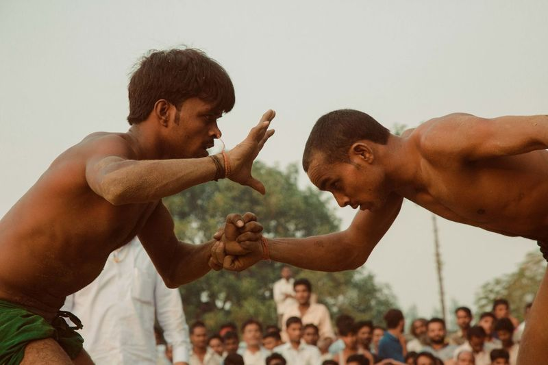 Dangal, also known as Kushti, is an Indian form of wrestling played in mud. It is still popular form of entertainment and spoort in smaller towns and villages in India. Pictured here is a local competition held in a popular fair in Deva, Barabanki, India. Dangal India Indian Wrestling Kushti Sports Street Photography Streetphotography The Street Photographer - 2017 EyeEm Awards Wrestling Mix Yourself A Good Time Be. Ready. This Is Masculinity Summer Sports