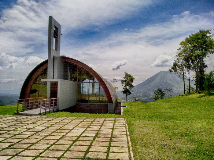 Chapel of the Virgin Mary, located in the area of the Mount of Prayer Mahawu Tomohon. Architecture Building Exterior Chapel Chapelhill Cloud Cloudy Day Entrance Hill No People Outdoors Sunlight