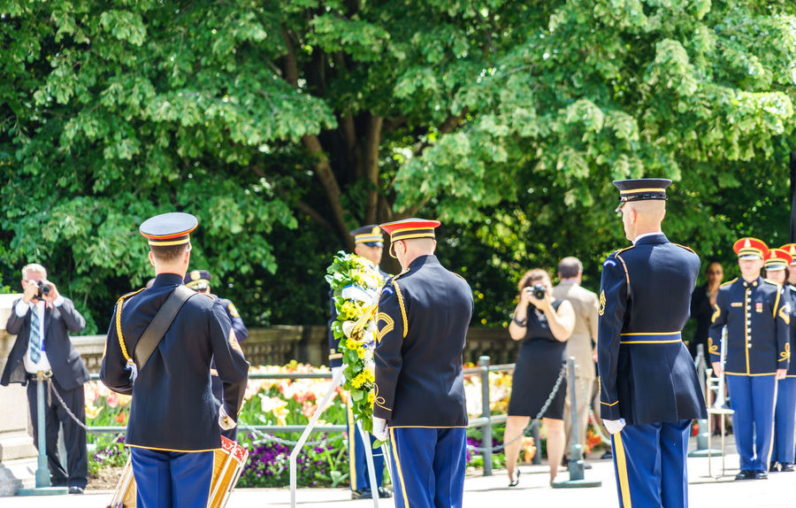 Arlington National Cemetery Armed Forces Casual Clothing Crowd Day Graveyard Green Color Group Of People Heroes Honor Guard Large Group Of People Leisure Activity Lifestyles Medium Group Of People Men Military Outdoors Person Police Respect Soldiers Tomb Of The Unknown Soldier Tree Up Close Street Photography Washington, D. C.