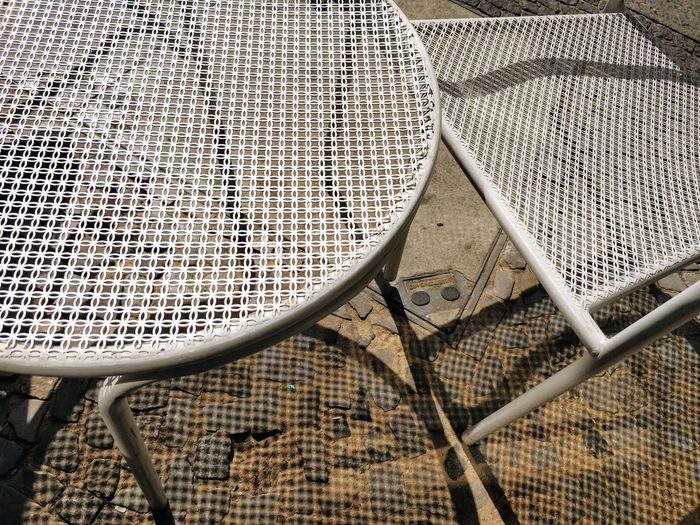 Sun hitting the ground Table Chair Coffee Shop Break Relaxing Tranquility Shadows & Lights Shadow Full Frame High Angle View Pattern Close-up Mosaic Seamless Pattern Calm Tranquil Scene Sidewalk Cafe
