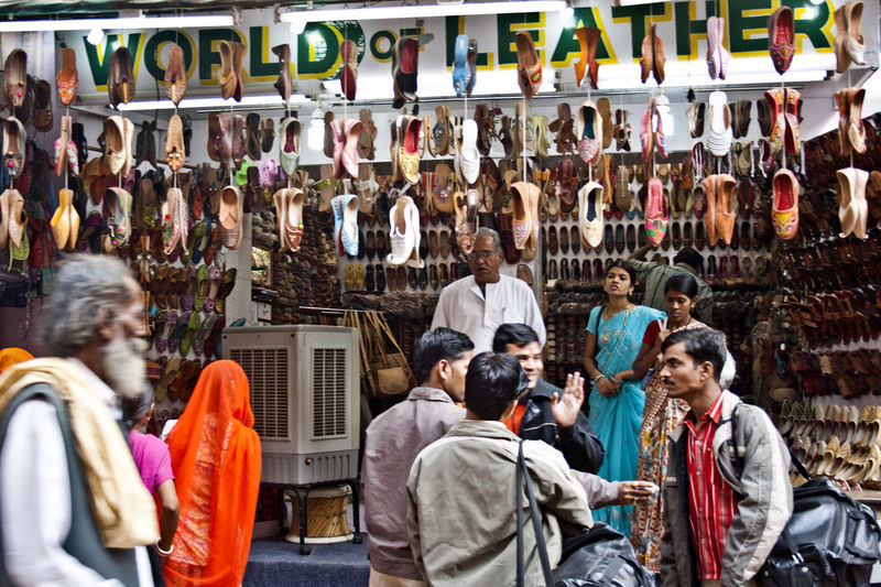 People at market stall in city