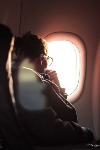 Lifestyles One Person Sitting Music Real People Leisure Activity Indoors  Young Adult Close-up Adult Nature People Sky Airplane Flight Sunrise Morning Los Angeles, California LAX Warm Window Plane Window Millennial Pink