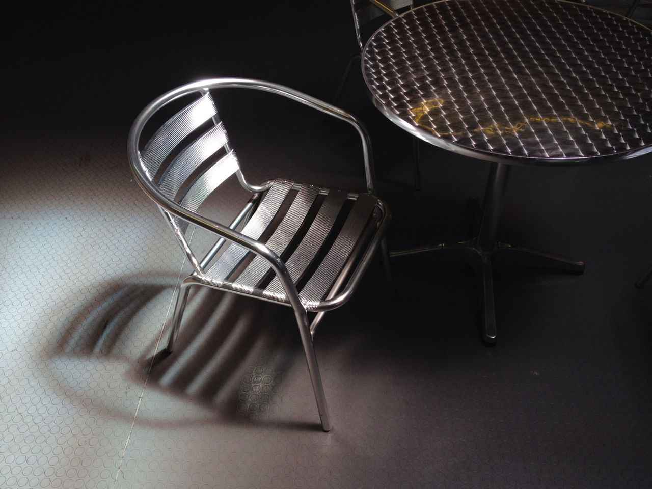 Metallic chair and table in cafe