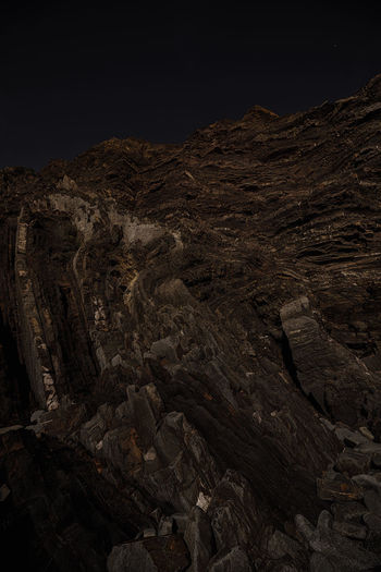 Rock Rock - Object Solid No People Nature Geology Tranquility Sky Scenics - Nature Mountain Textured  Rock Formation Beauty In Nature Rough Night Tranquil Scene Land Physical Geography Non-urban Scene Landscape Outdoors Dark Eroded Arid Climate